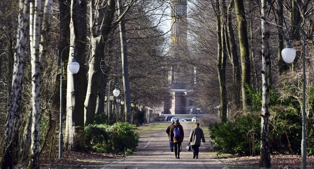People take a stroll at Tiergarten park in Berlin, Saturday, March 4, 2017