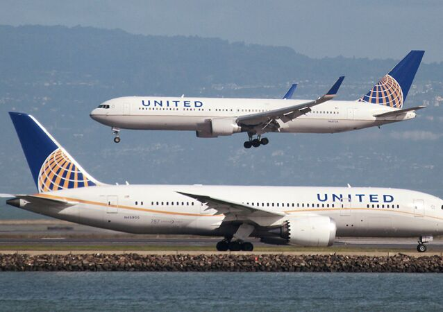 A United Airlines Boeing 787 taxis as a United Airlines Boeing 767 lands at San Francisco International Airport, San Francisco, California, U.S. on February 7, 2015