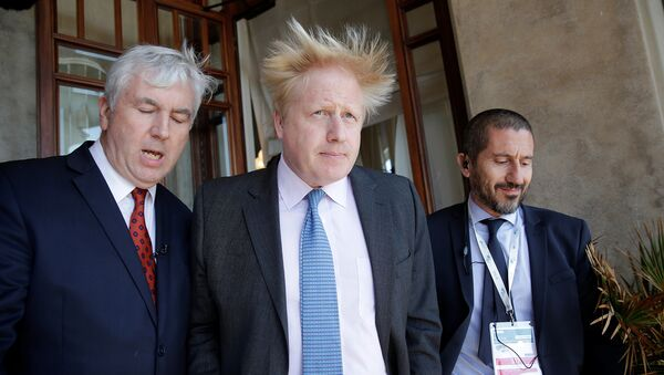 Britain's Foreign Secretary Boris Johnson (C) leaves at the end of a bilateral meeting during a G7 for foreign ministers in Lucca, Italy April 10, 2017 - Sputnik International