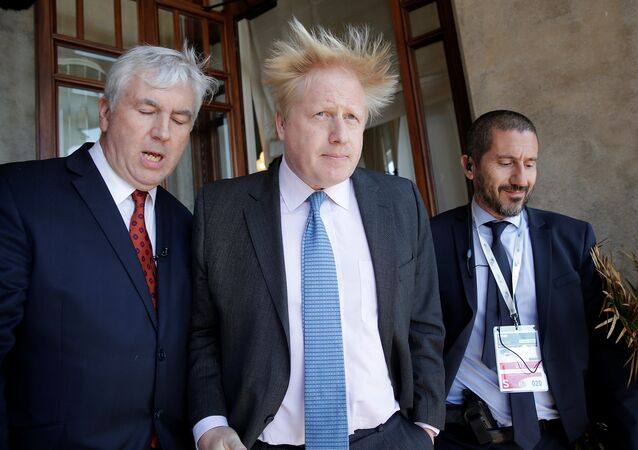 Britain's Foreign Secretary Boris Johnson (C) leaves at the end of a bilateral meeting during a G7 for foreign ministers in Lucca, Italy April 10, 2017