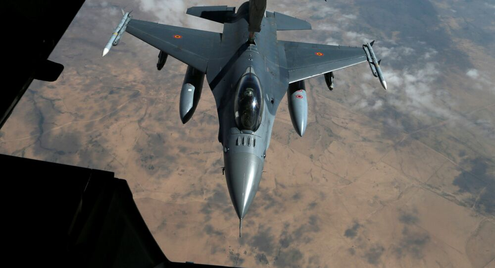 A  French Air Force F-16 receives fuel from a fuel boom suspended from a US Air Force KC-10 Extender during mid-air refueling support to Operation Inherent Resolve over Iraq and Syria air space, March 15, 2017