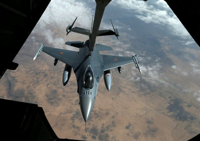 A US Air Force F-16 receives fuel from a fuel boom suspended from a US Air Force KC-10 Extender during mid-air refueling support to Operation Inherent Resolve over Iraq and Syria air space, March 15, 2017