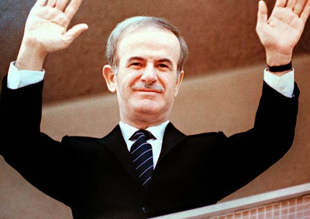 Photo dated 12 March 1985 of late Syrian President Hafez al-Assad acknowledging the crowd after beinb elected to a third seven-year term in front of parliament in Damascus