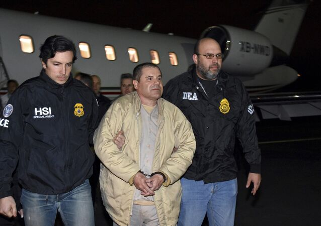 In this Jan. 19, 2017 file photo provided by U.S. law enforcement, authorities escort Joaquin El Chapo Guzman