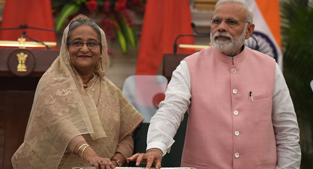 Indian Prime Minister Narendra Modi (R) and Bangladesh Prime Minister Sheikh Hasina jointly inaugurate a major road named after Bangabandhu Mujibur Rehman during an agreement signing ceremony after a meeting in New Delhi on April 8, 2017
