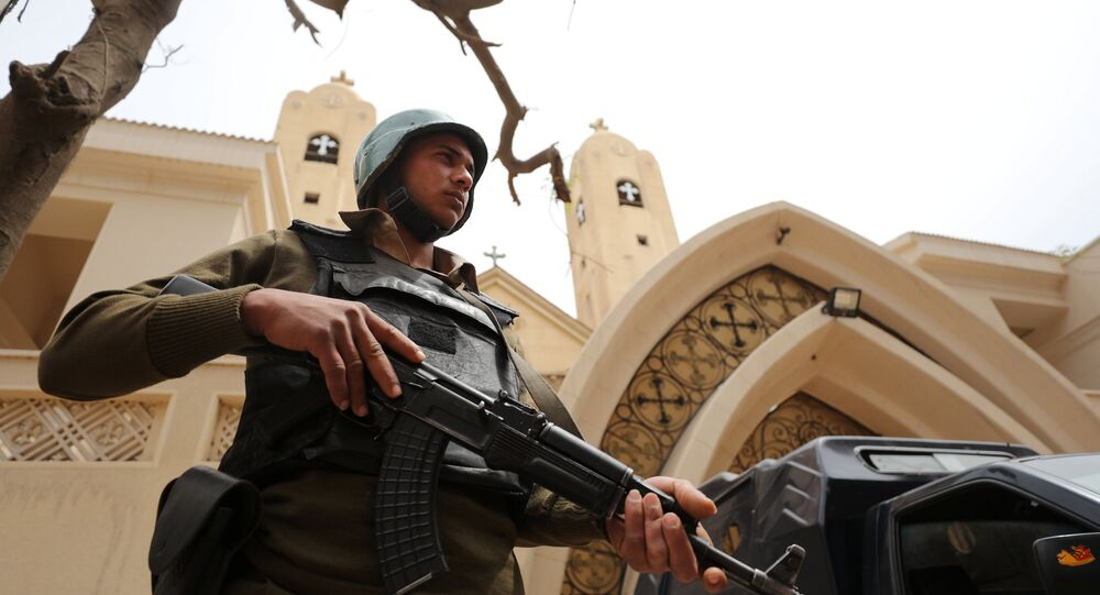 An armed policeman secures the Coptic church that was bombed on Sunday in Tanta, Egypt April 10, 2017