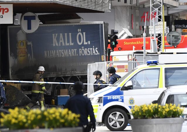 Police cordons the truck which crashed into the Ahlens department store at Drottninggatan in central Stockholm, April 7, 2017