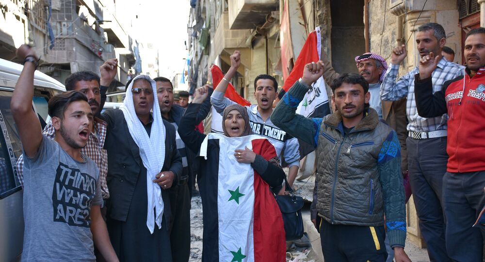 Syrians, who fled their hometown due to the fighting, gesture and shout slogans upon their return to Aleppo's Myassar neighbourhood on April 5, 2017