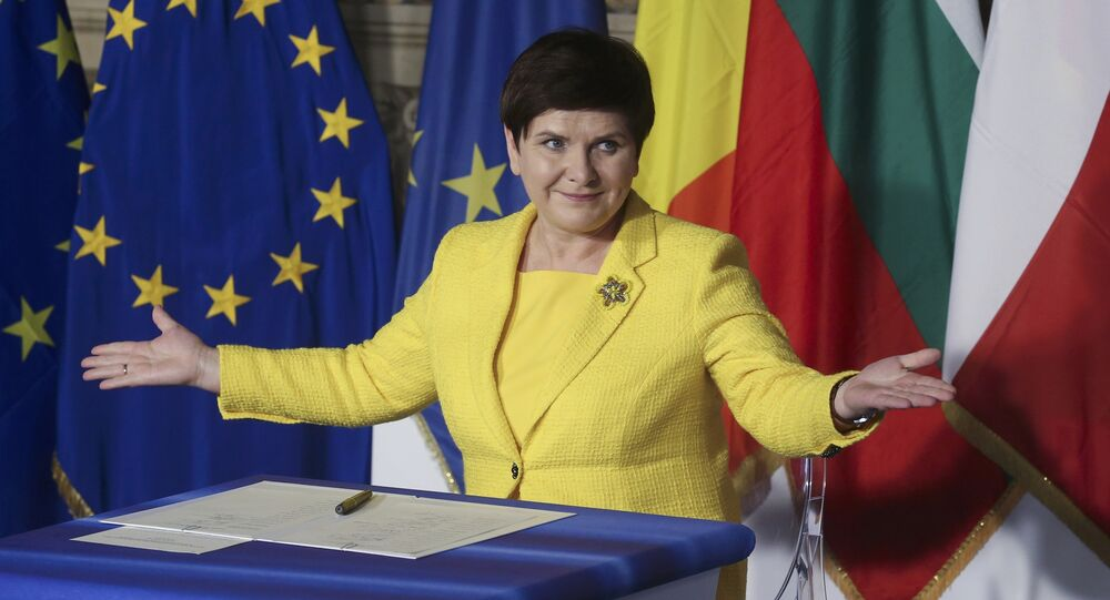 Poland's Prime Minister Beata Maria Szydlo reacts after signing document during the EU leaders meeting on the 60th anniversary of the Treaty of Rome, in Rome, Italy March 25, 2017.