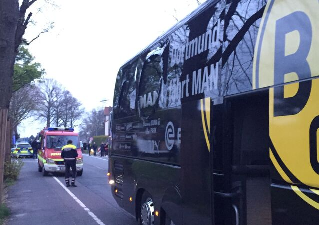 A window of the bus of Borussia Dortmund is damaged after an explosion before the Champions League quarterfinal soccer match against AS Monaco in Dortmund, western Germany, Tuesday, April 11, 2017.