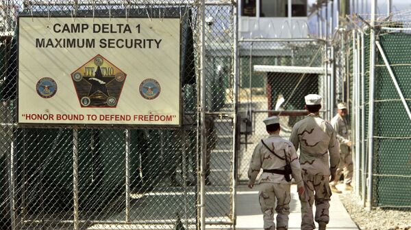 US military guards walk within Camp Delta military-run prison, at the Guantanamo Bay US Naval Base, Cuba. - Sputnik International