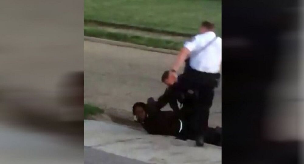 WATCH: Ohio Officer Caught on Cam Kicking a Handcuffed Suspect Reassigned