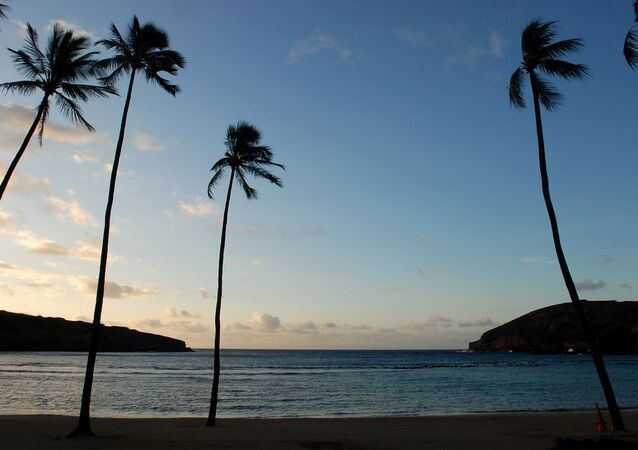 the sun rises over Oahu's Hanauma Bay near Honolulu