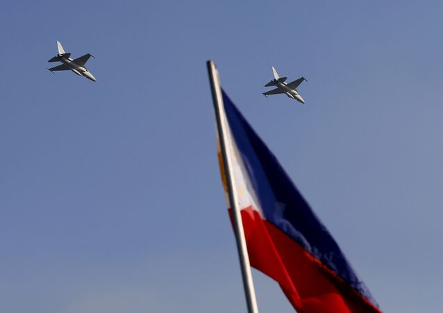 Two newly-acquired FA-50 fighter jets from South Korea make a high-speed pass over the Rizal Park during flag-raising rites in 2013