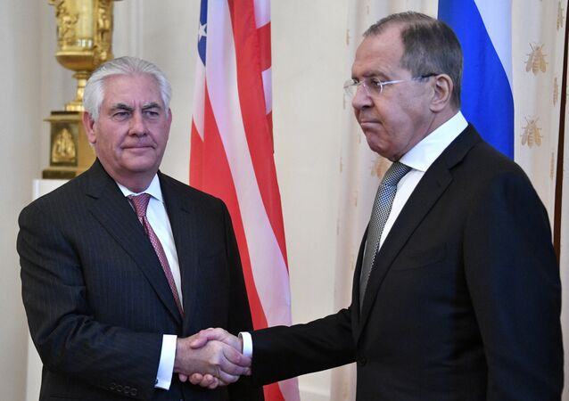 Russian Foreign Minister Sergei Lavrov (R) welcomes US Secretary of State Rex Tillerson before a meeting in Moscow on April 12, 2017