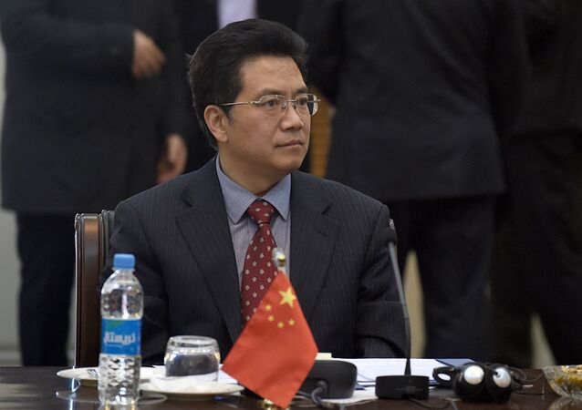 Chinese Special representative for Afghanistan, Deng Xijun listens to Afghan Foreign Minister, Salahuddin Rabbanion (unseen) as he chairs the second round of four-way peace talks meeting at the Presidential palace in Kabul on January 18, 2016