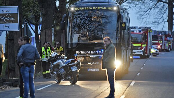 A window of Dortmund's team bus is damaged after an explosion before the Champions League quarterfinal soccer match between Borussia Dortmund and AS Monaco in Dortmund, western Germany, Tuesday, April 11, 2017 - Sputnik International