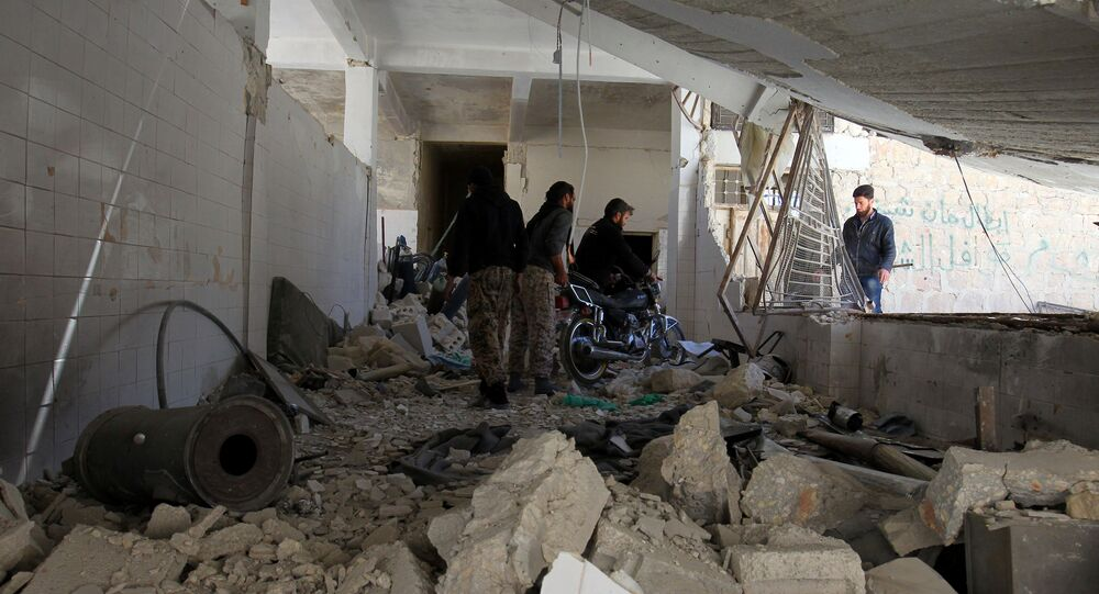 Men salvage a motorbike amid the damage inside a medical point at a site hit by airstrikes on Tuesday, in the town of Khan Sheikhoun in rebel-held Idlib, Syria April 5, 2017