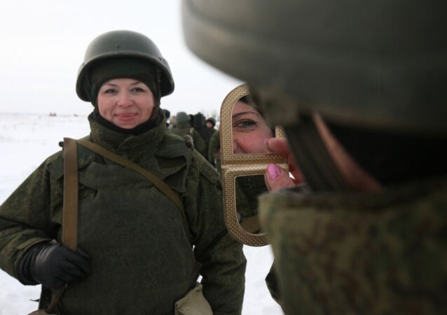 A female soldier looks in the mirror ahead of a firing exercise at a shooting range of a Russian Airborne Forces Training Center. File photo