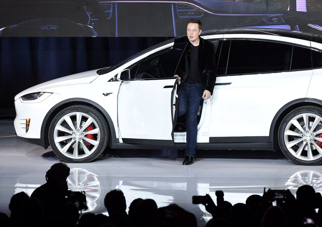 Elon Musk, CEO of Tesla Motors Inc., introduces the Model X car at the company's headquarters Tuesday, Sept. 29, 2015, in Fremont, California, US.