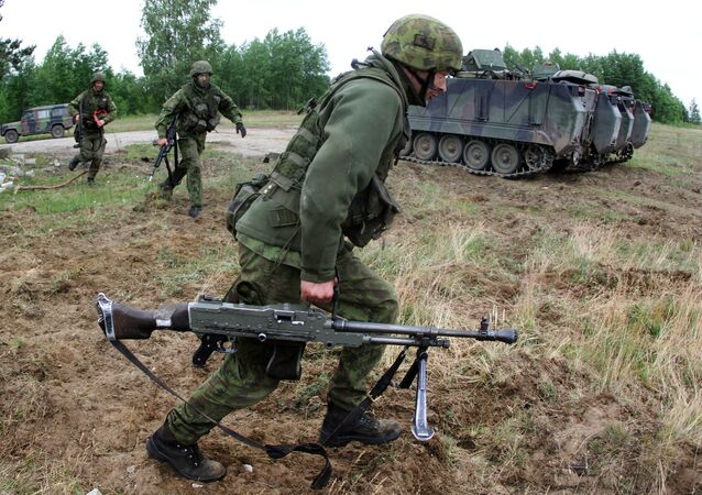 Lithuanian soldiers take part in a field training exercise during the first phase Saber Strike 2014, at the Rukla military base, Lithuania, on June 14, 2014