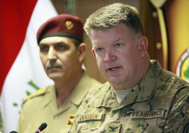 Col. John Dorrian, right, a U.S. spokesman for the coalition, speaks during a press conference with Brig. Gen. Yahya Rasool, an Iraqi military spokesman in Baghdad, Iraq, Tuesday, April 11, 2017