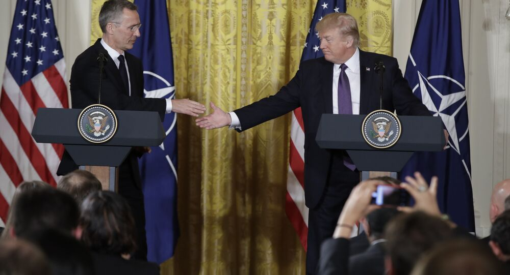 President Donald Trump reaches to shake hands with NATO Secretary General Jens Stoltenberg during a news conference in the East Room of the White House, Wednesday, April 12, 2017, in Washington.