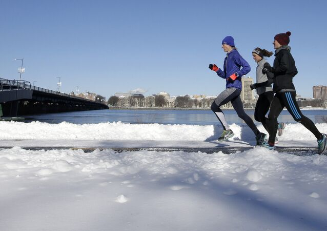 Runners make their way along a path next to the Charles River, Sunday, Jan. 8, 2017, in Boston