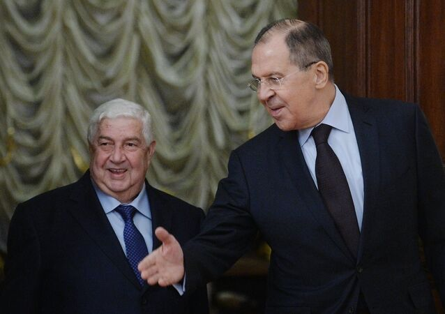 Russian Foreign Minister Sergey Lavrov, right, and Syrian Foreign Minister Walid al Muallem during their meeting in Moscow