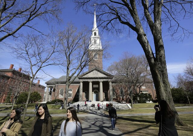 In this Sunday, March 13, 2016, photo people walk near Memorial Church, behind, on the campus of Harvard University, in Cambridge, Mass. Amid scrutiny from Congress and campus activists, colleges across the country are under growing pressure to reveal the financial investments made using their endowments.
