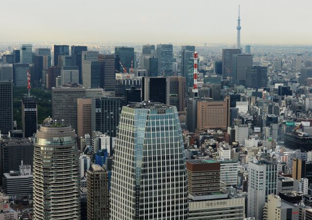 Tokyo's Minato District. Foreground is the Atago Green Hills Mori Tower skyscraper. Foreground, left is the Atago Green Hills Forest Tower skyscraper.