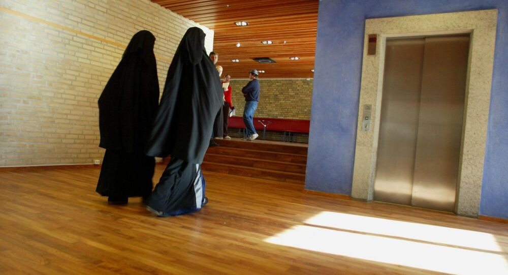 Two muslim girls with burqas is walking inside the Burgarden secondary school in sweden vestern town Gothenburg  (photo used for illustration purpose)