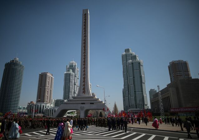 Korean People's Army soldiers and city residents at a ceremony to open a new residential area on Ryomyong Street in Pyongyang.