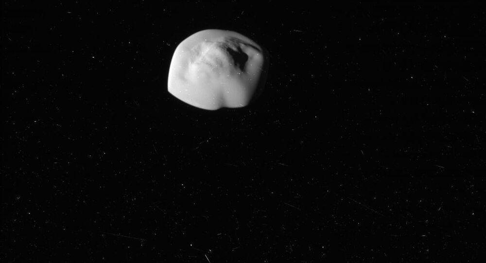 Atlas, the flying saucer moon of Saturn. Photo taken by NASA's Cassini Probe.