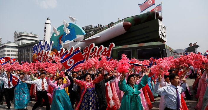 People react as they march past the stand with North Korean leader Kim Jong Un during a military parade marking the 105th birth anniversary of the country's founding father Kim Il Sung, in Pyongyang, April 15, 2017.