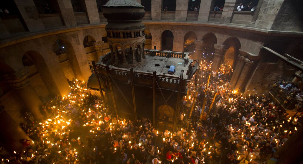 Christian Orthodox pilgrims hold candles during Holy Fire ceremony in the church of the Holy Sepulchre. (File)