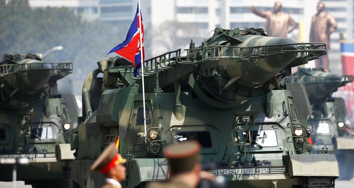Missiles are driven past the stand with North Korean leader Kim Jong Un and other high ranking officials during a military parade marking the 105th birth anniversary of the country's founding father, Kim Il Sung in Pyongyang, April 15, 2017.
