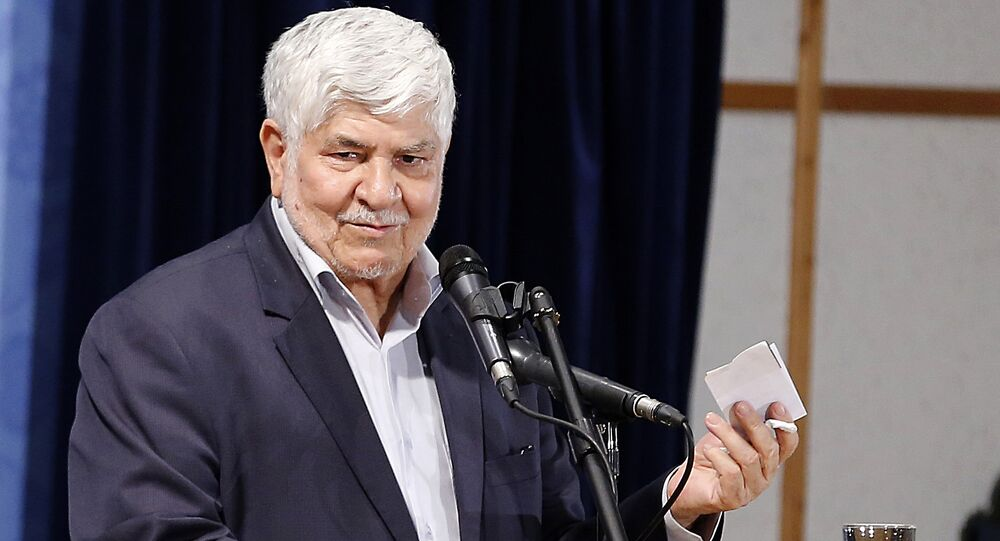 Mohammad Hashemi speaks after registering his candidacy for the upcoming presidential elections at the ministry of interior in the capital Tehran