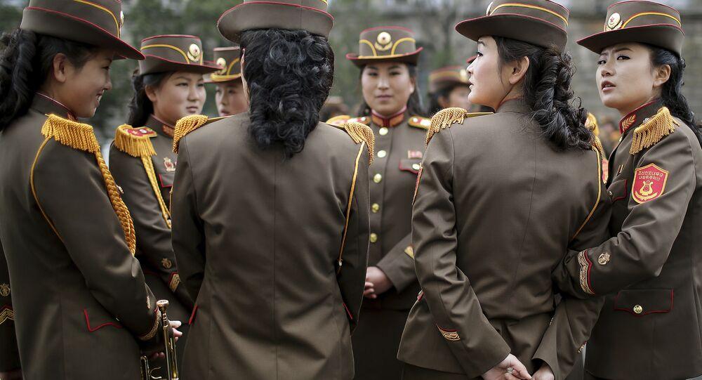 North Korean military band members chat before a military parade on Saturday, April 15, 2017