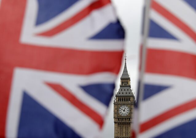 British Union flags displayed on a tourist stall, backdropped by the Elizabeth Tower at the Houses of Parliament, in central London, Wednesday, March 29, 2017.