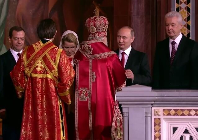Russian President Putin and Prime Minister Medvedev Attend Easter Mass in Moscow