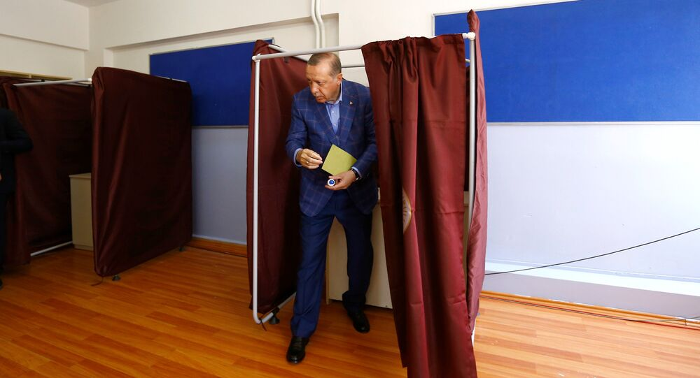 Turkish President Tayyip Erdogan leaves a voting booth at a polling station during a referendum in Istanbul, Turkey, April 16, 2017.