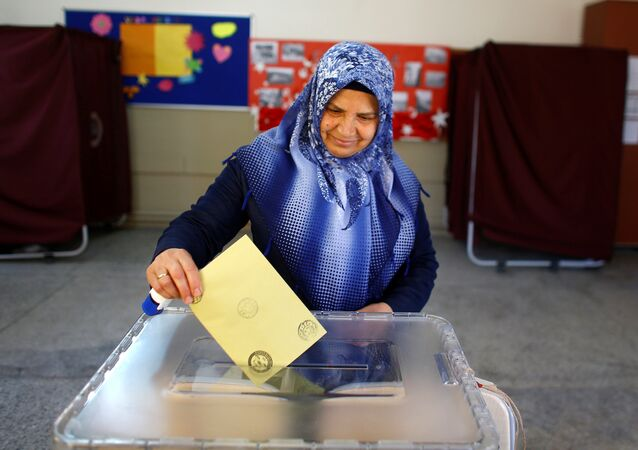 A woman casts her ballot at a polling station during a referendum Aegean port city of Izmir, Turkey
