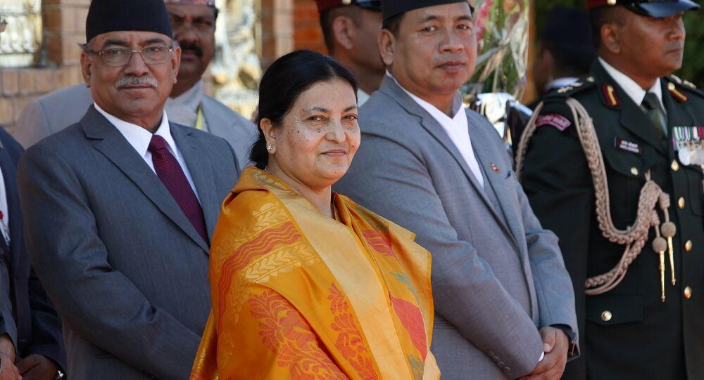 Nepalese president Bidhya Devi Bhandari, (2L), Vice President Nanda Kishor Pun, (2R), and Prime minister Pushpakamal Dahal (L) wait to receive Indian President Pranab Mukherjee on his arrival at Tribhuvan International Airport in Kathmandu on November 2, 2016