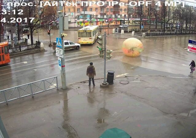 Russian Man Rolls Through Busy Intersection in Gigantic Inflated Balloon