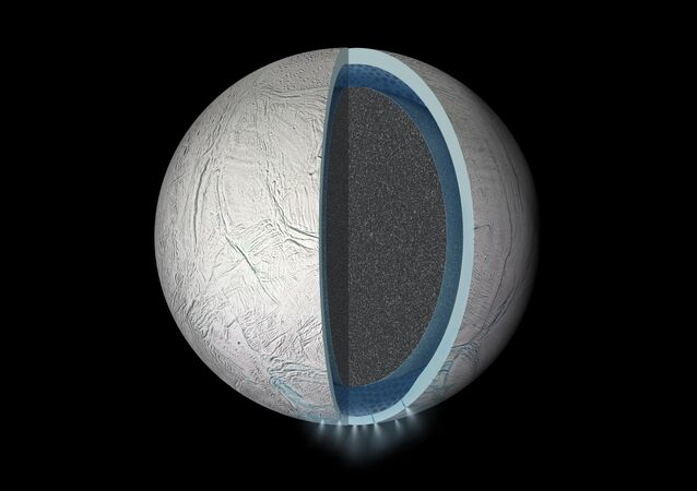 Illustration of the interior of Saturn's moon Enceladus showing a global liquid water ocean between its rocky core and icy crust. Thickness of layers shown here is not to scale.