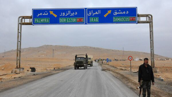 A picture taken on March 2, 2017, shows a sign displaying the routes to Palmyra-Deir Ezzor and Damascus-Iraq - Sputnik International
