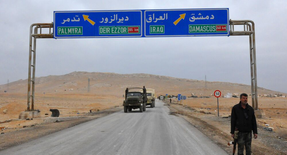 A picture taken on March 2, 2017, shows a sign displaying the routes to Palmyra-Deir Ezzor and Damascus-Iraq