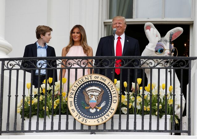 U.S. President Donald Trump stands with his son Barron (L-R), first lady Melania Trump and a performer in an Easter Bunny costume on the Truman Balcony during the White House Easter Egg Roll in Washington, U.S., April 17, 2017