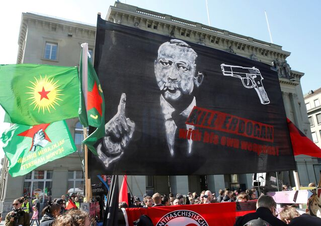 People hold banners and flags during a demonstration against Erdogan dictatorship and in favour of democracy in Turkey, in Bern, Switzerland March 25, 2017